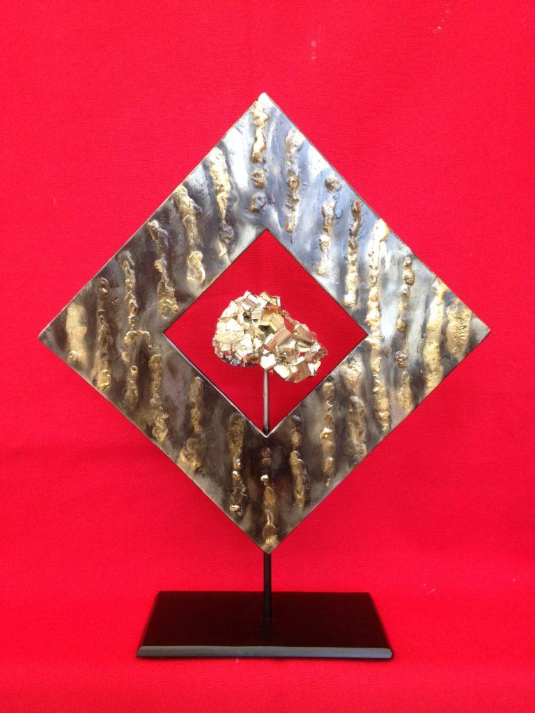 Création en fer forgé et pyrite